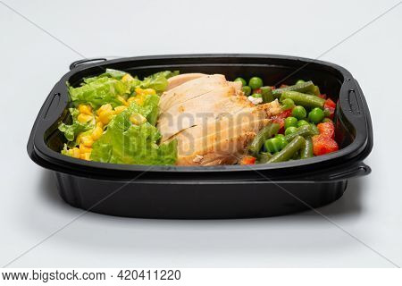 Ready Food In A Container. Stewed Chicken, Stewed Vegetables. Isolated On A White Background.