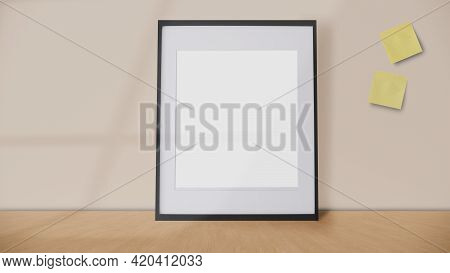Blank Frame And Yellow Postit On A Vintage Wall Background With Window Shadow.