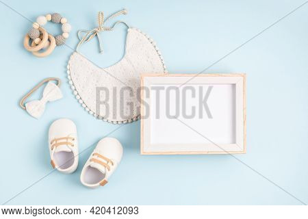 Mockup Of Empty Frame With White Baby Accessories, Baby Shower, Baptism Invitation
