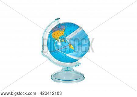 Earth Globe In Sterile Medical Mask. World Medical Concept,coronavirus Epidemic In The World,global