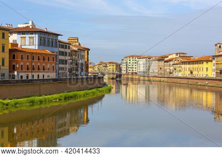 Pisa, Italy- May 11, 2019: View On Arno River And Colorful Building, Reflection In Water