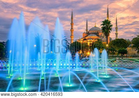 Blue Mosque (sultanahmet Camii) With Blue Illuminated Fountain In The City Center Of Istanbul, Turke