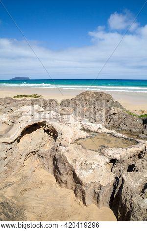 Coastal Rocks On A Beach Of Porto Santo, Island In The Madeira Archipelago, Portugal. Vertical Lands