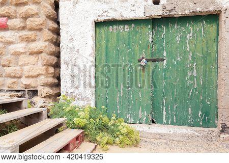 Green Wooden Gate Of A Coastal Barn For Boats. Porto Santo Island In The Madeira Archipelago, Portug