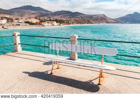 Vila Baleira Landscape With White Bench On Pier On A Sunny Day. Portugal, Island Of Porto Santo In T