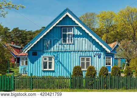 Nida, Lithuania - May 10 2021: Beautiful Old Lithuanian Traditional Wooden Light Blue House Of The C