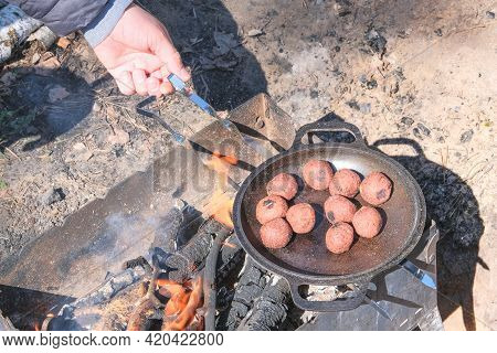 Vegan Falafel Cook In A Pan Outdoors. Middle East Culture. Wood Fire Prepared For Grill On Nature. P