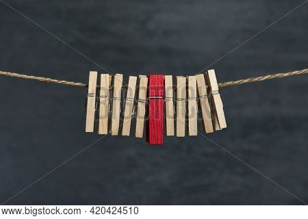 Wooden Clothespins On A Rope. Not Like Everyone. Difference From Others