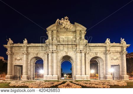 The Puerta De Alcala Is A Monument In The Plaza De La Independencia In Madrid, Spain.