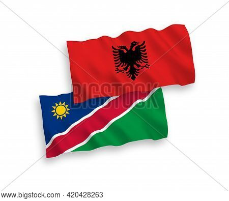 National Fabric Wave Flags Of Republic Of Namibia And Albania Isolated On White Background. 1 To 2 P