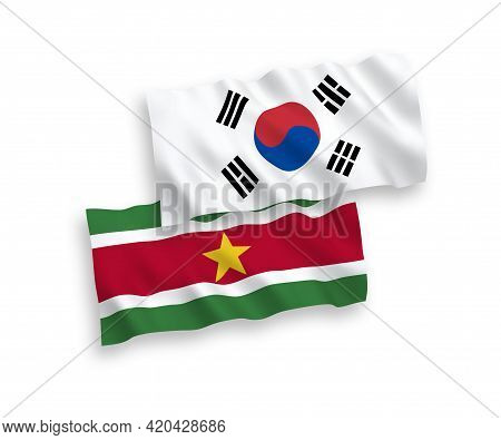 National Fabric Wave Flags Of South Korea And Republic Of Suriname Isolated On White Background. 1 T