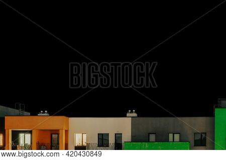 Residential House Against Solid Black Background. Isolated. Darkness. Building At Night. Dark. Eveni