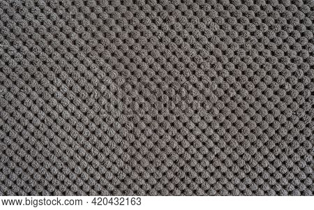 Sofa Upholstery Close-up. Texture Of Rough Dense Ribbed Fabric. Beige Background For Layouts. Beige