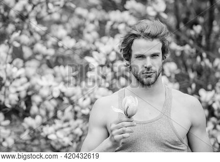 Man Flowers Background Defocused. Botany Nature. Male Beauty. Hair Care And Beauty. Unshaven Man Mag