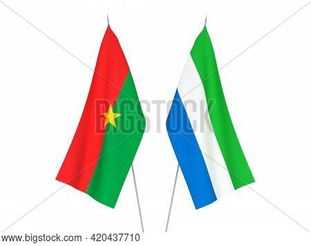 National Fabric Flags Of Sierra Leone And Burkina Faso Isolated On White Background. 3d Rendering Il