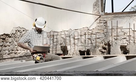 Construction Worker Wear Helmet And Use Computer, House Renovation Project Plan, Work Concept, Sitti