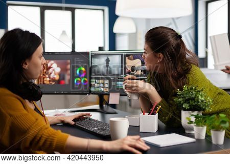 Coworkers Video Editors Discussing In Front Of Pc Working For Client Footage Using Post Production S