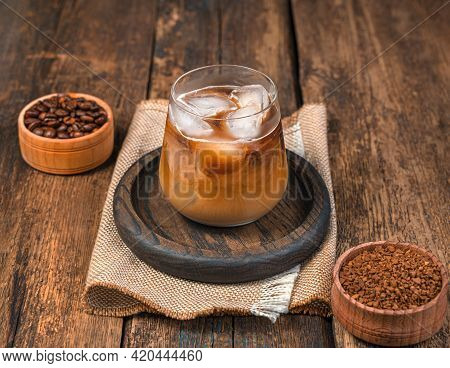 Iced Coffee On A Wooden Background. A Refreshing, Invigorating Drink. Side View.