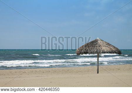 One Straw Umbrella On A Forte Dei Marmi Shore