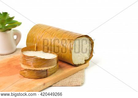Malaysian Traditional Food Called As Lemang On Wooden Board. Glutinous Rice Is Wrapped With Lerek Or