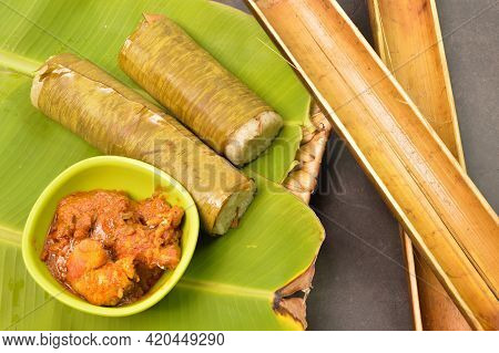 Malaysian Traditional Food Called Lemang And Chicken Rendang On Banana Leaves. Glutinous Rice Is Wra