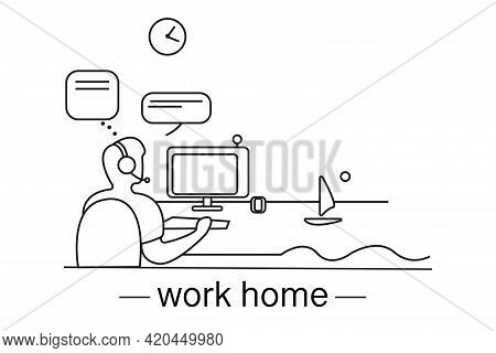 Work Home. The Man Is Sitting At The Table. A Young Man Works From Home. The Guy In Front Of The Com