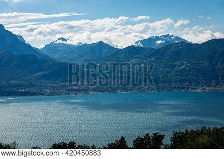 Lago Di Garda. Elevated View Of The Lake Garda With The Lombardy Coastline Seen From The Monte Baldo
