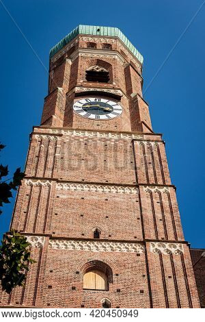 Close-up Of One Of The Two Bell Towers Of The Munich Cathedral In Gothic Style (1468-1488). Frauenki