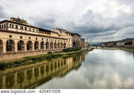 Florence. Arno River View From The Medieval Ponte Vecchio (old Bridge). On The Left The Vasari Corri