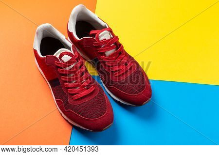 A Pair Of Sports Shoes On A Colorful Background. New Sneakers On Multi-colored Background, Copy Spac