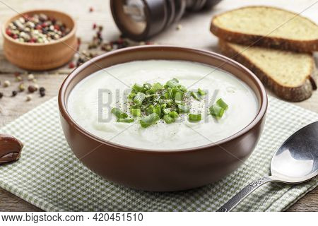Cauliflower Cream Soup On A Table In A Clay Plate. Nearby Are Spices. Space For Text
