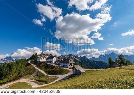 Lussari Village Or Monte Santo Di Lussari (1790 M) With The Mountain Range Of Mangart, Jof Di Montas