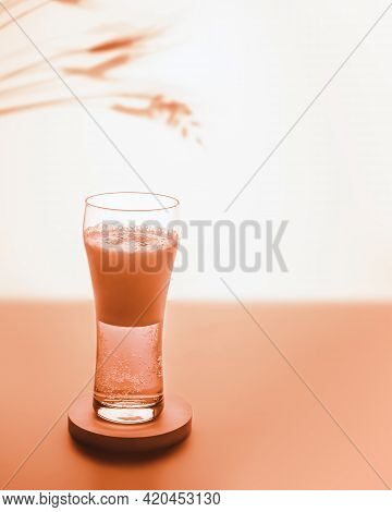 Select Focus Composition With Glass Filled With Light Beer With Foam On Sunset Summer Background Wit