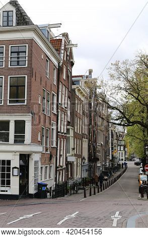 The Characteristic Buildings Of The City Of Amsterdam. High Quality Photo