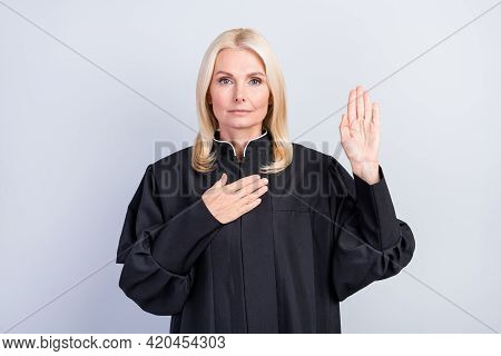 Photo Of Serious Sincere Old Woman Hold Hand Heart Chest Give Pledge Judge Clothes Isolated On Grey