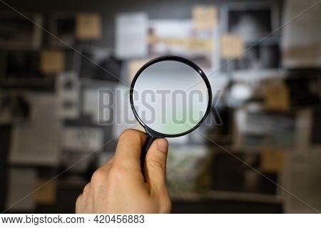 Police Inspection Looking For Clues On Investigation Board