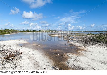The View Of A Lagoon On A Hot Summer Day With An Industrial Complex In A Background On Grand Turk Is