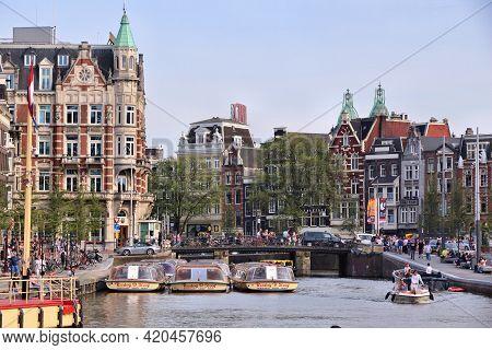 Amsterdam, Netherlands - July 7, 2017: Boat Tours In Rokin Canal In Amsterdam, Netherlands. Amsterda