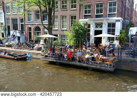 Amsterdam, Netherlands - July 7, 2017: People Visit Summer Cafe At Egelantiers Gracht In Amsterdam,