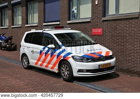 Amsterdam, Netherlands - July 7, 2017: Police Car Parked In Front Of Police Station In Amsterdam, Ne