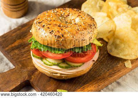 Homemade Bagel Turkey Sandwich With Lettuce