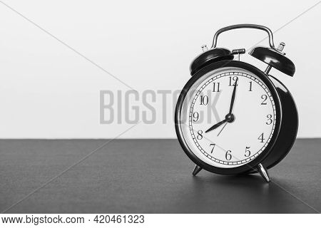 Classic Alarm Clock On Black And White Background. Time Concept.