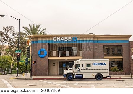Pasadena, Ca, Usa - May 11, 2021: White Brinks Armed Money Transport Truck In Front Of Blue Logo Cha