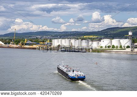 A Large Barge For The Transport Of Liquid Fuels On The Rhine In Germany. In The Background, On The R