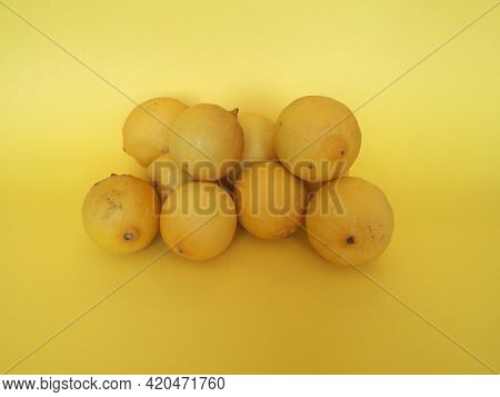 Lemon Fruits Over Yellow Background