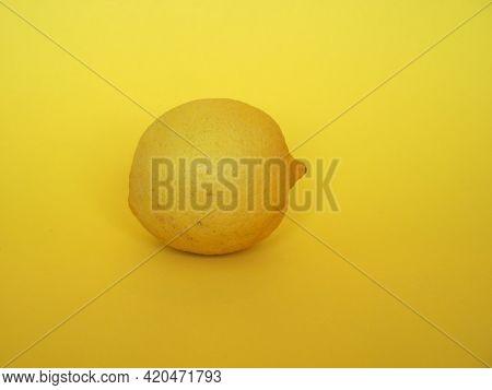 Lemon Fruit Over Yellow Background