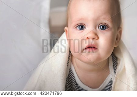Close Up Portrait 9 Month Old Baby With White Towel. Teething, Bathing, Healthy Sleep Toddler.