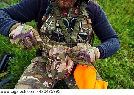 An Airsoft Player Zipping Up His Bag