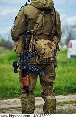 Close-up View Of The Back Of An Airsoft Player Of A Russian Soldier