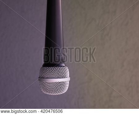Hung Microphone. You Can See Almost The Entire Microphone With The Entire Metal Top. Behind You Can